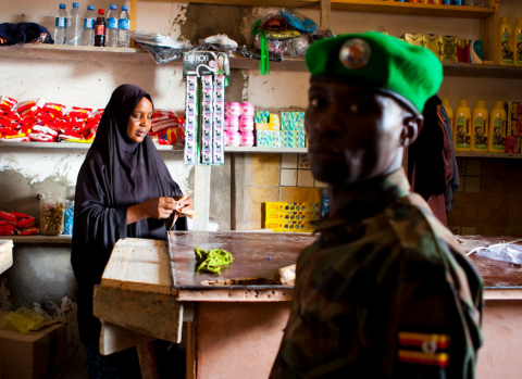 Ugandan soldier shops at small store near front lines