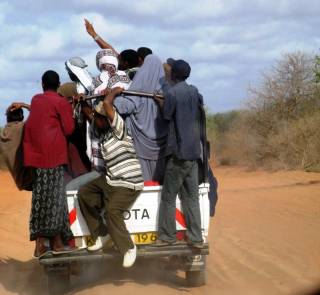 Asylum seekers crowd aboard a pickup bound for the Kenyan border