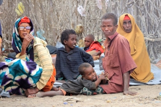 IDP family waiting for aid