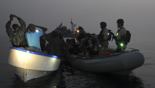 Navy Arresting Pirates At Sea